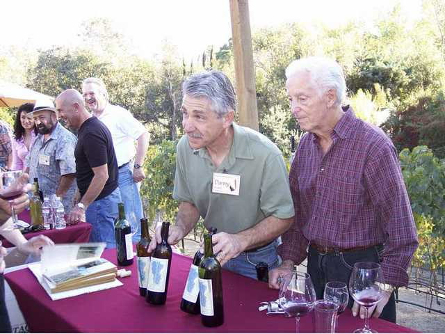 Danny Mascari and Carmen D'Argenzio display their Bouquet Vineyard wine.