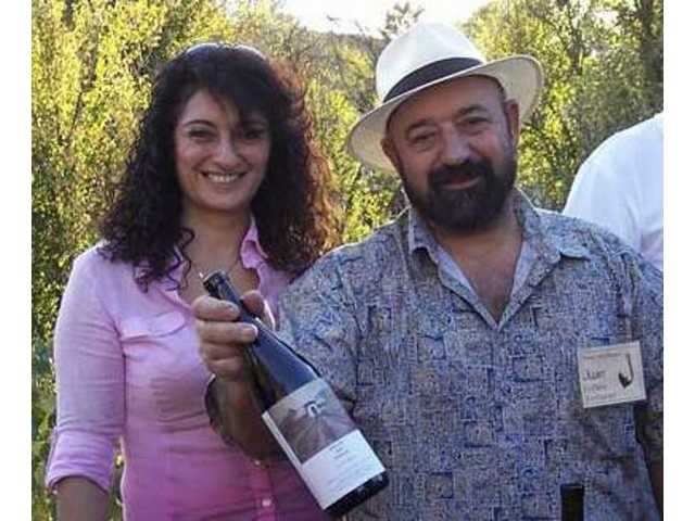 Claudia and Juan Alonso of Le Chene French Cuisine in Agua Dulce with Alonso's own private label wine, Felix 2005 Syrah.