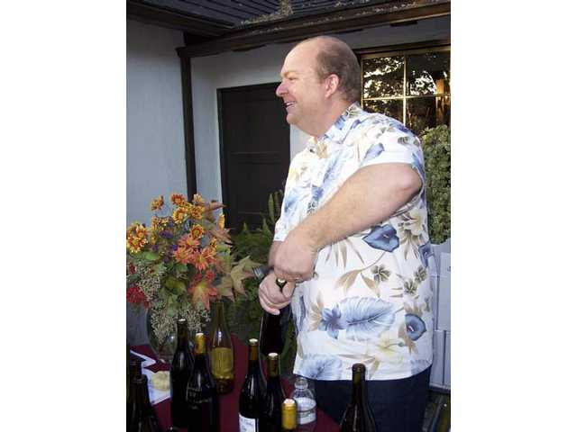 "Chris Connolly of Les Deux Chats Cellars in Valencia uncorks a bottle of wine for ""Sunset"" guests."