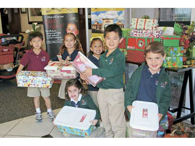 Legacy Christian Academy students participate in this year's Operation Christmas Child and helped fill boxes to send to children in impoverished and war-torn countries. Students earned an hour of community service for every box they filled. More than 300 boxes were filled by the group.