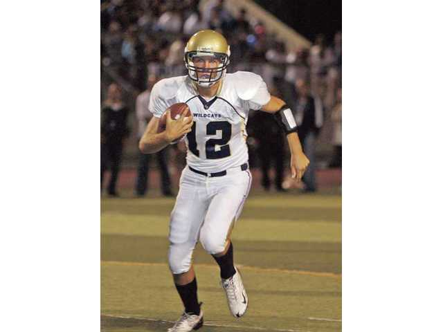 West Ranch quarterback Connor Eichten runs against Saugus at College of the Canyons on Oct. 23.