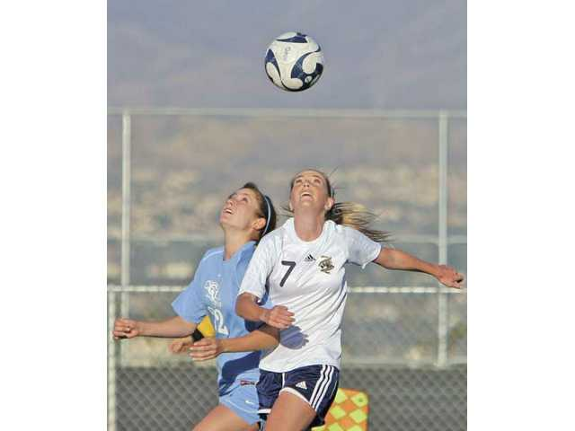 Crescenta Valley's Dana Dowse (22) and West Ranch's Megan McDonald (7) fight to gain possession during their match on Tuesday.