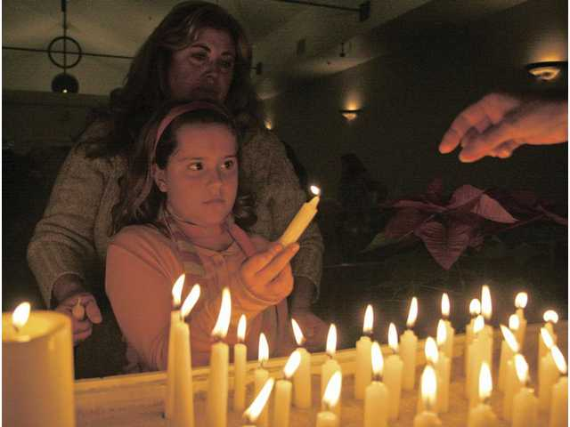 Eight-year-old Ashley Boron, left, and mom Kate Boron remember Joe Boron, their father and husband, during the annual non-denominational Service of Remembrance in the Chapel of the Hills at Eternal Valley Memorial Park and Mortuary in Newhall on Wednesday. Joe Boron died Feb. 14, 2009.