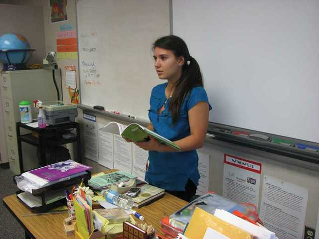 Saugus High School junior Brittany Rodi makes a point to her Fair Oaks Ranch Community School students.