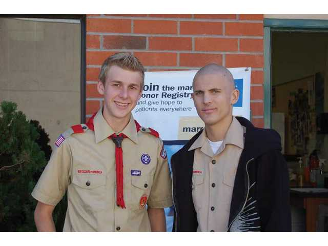 Eagle Scout Justin Wilson, left, organized a bone-marrow drive for his life-long friend Nate Sparks.