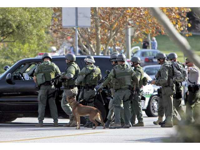 Los Angeles County Sheriff's SWAT team and canine unit prepare to enter the home on the corner of Kavenaugh Lane and O'Hara Lane where they believe a suspect was hiding after reports of a burglary on Tuesday morning.