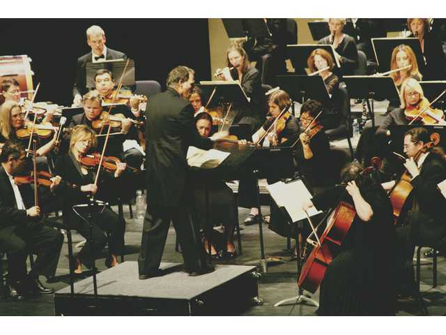 Santa Clarita Symphony maestro Robert E. Lawson conducts the orchestra during a recent appearance at the Santa Clarita Performing Arts Center at College of the Canyons.