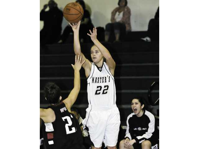The Master's College's Brooke Bekandam (22) shoots over APU's Cherie Hughes Friday at Bross Gym.
