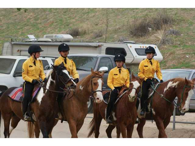 Troop A rides in a group of four for a California Rangers annual regimental show at Don-e-brook farms Dec. 7. Four youth cavalry troops from Santa Clarita were represented at the event.