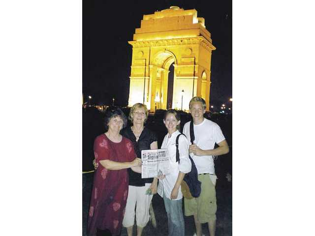 Kitty Conant, far left, Linda Fleming, Alyssa Staples and Andrew Johnson visited the India Gate in New Delhi, India. The gate is a memorial England gave to India after World War II to commemorate fallen soldiers.