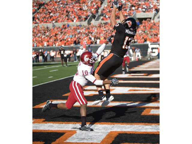 Oregon State's Shane Morales catches a touchdown pass over Washington State defender Romeo Pellum (10) on Oct. 11 in Corvallis.