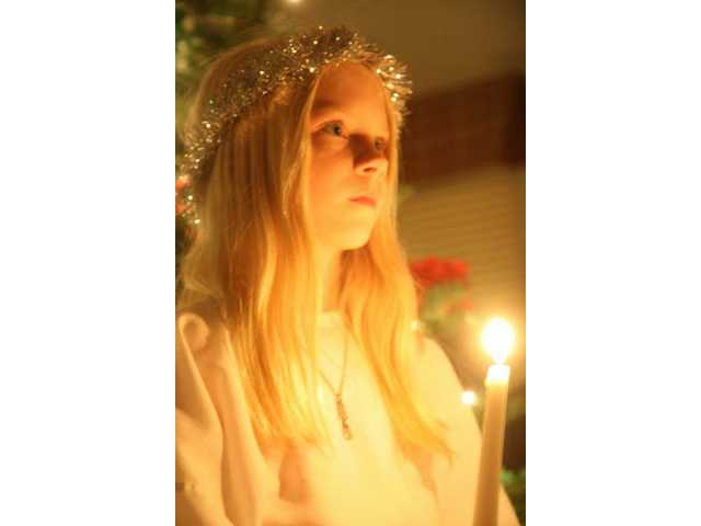 Ireland Moon sings a traditional Santa Lucia song in Swedish at a pageant hosted by the Nordic Heritage Lodge 741 in Valencia Sunday.
