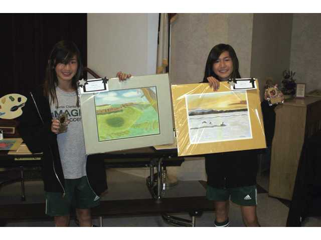 Alyssa and Kiara Lau, award of excellence and award of merit in visual arts, sixth grade.