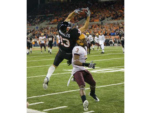 Oregon State senior wide receiver Shane Morales catches a pass over Arizona State defender Omar Bolden on Nov. 1 in Corvallis, Ore. Morales caught two touchdown passes in the game.