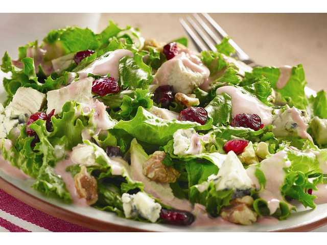 Turkey & Cranberry Encore SaladMakes about 8 servingsDRESSING    2/3     cup (5-fluid-ounce can) Nestlé Carnation Evaporated Milk    1/2     cup jellied or whole-berry cranberry sauce    1/4     cup Italian salad dressingSALAD    1     bag (10 ounces) mixed salad greens of your choice (about 10 cups)    2     cups (about 10 ounces) cooked turkey, cut into 1/2-inch pieces     1/2     cup (2 ounces) crumbled blue cheese    1/3     cup dried sweetened cranberries    1/2     cup chopped toasted walnuts (optional)FOR DRESSING:PLACE evaporated milk, cranberry sauce and Italian dressing in small jar or container; cover tightly with lid. Shake for 1 to 2 minutes. Makes about 1 1/2 cups. (Dressing can be made in advance and refrigerated for up to 2 days. Shake well before using.)FOR SALAD: TOSS greens, turkey, blue cheese and 3/4 cup dressing in large bowl. Sprinkle with cran­berries and walnuts. Serve immediately and with additional dressing, if desired. Refrigerate any remaining dressing.