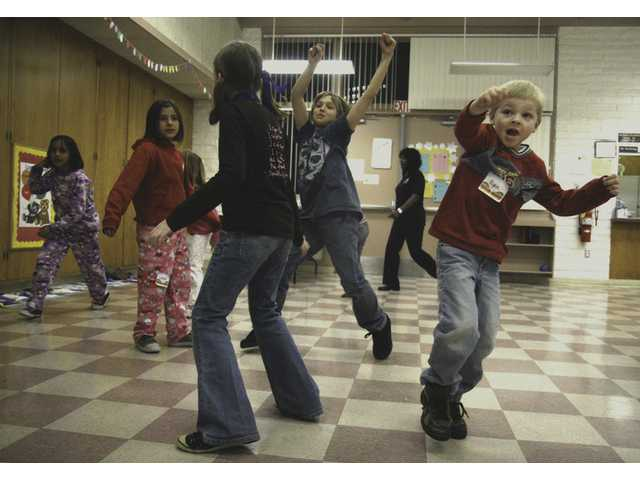 Kids play a game of freeze dance during Kids' Night Out Friday at the community room at Santa Clarita Park.