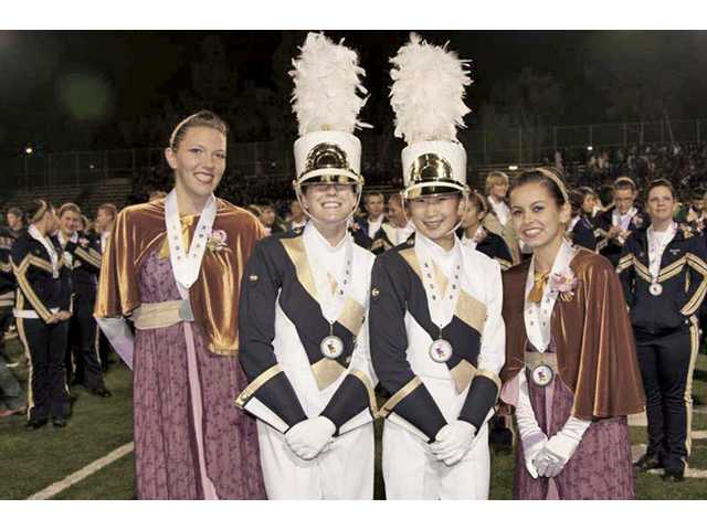 Guard Captain Sarah Strode, Assistant Drum Major Emily Brown, Drum Major Joyce Choi and Assistant Guard Captain Liz Malloy of the West Ranch High School Marching Band and Colorguard celebrate taking home the silver medal during the Dec. 5 state championships.