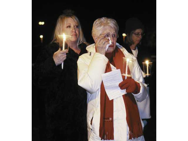 Santa Clarita residents gather in Canyon Country Sunday night to light candles celebrating the lives of those who died much too young. The Compassionate Friends organization, which hosts the event, estimates tens of thousands participate in the ceremony each year and the event is believed to be the world's largest mass candle lighting.