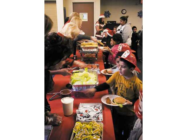 Children from around the city enjoyed lunch with santa and members of the L.A. County Fire Dept. Station 149 at the Castaic Sports Complex.