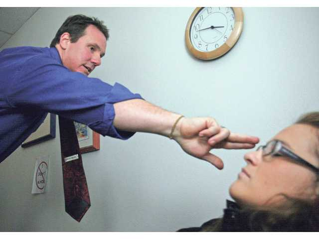 Scott Spackey treats clients with hypnotherapy at his Newhall office. Hypnotherapy is a technique that relaxes patients so they can use their subconscious to help resolve issues such as phobias or addictions.