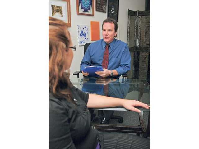 Scott Spackey, a hypnotherapist in Newhall, meets with clients before performing hypnotherapy to determine the particular issues that drove them to seek relief. Quitting smoking and losing weight are two of the most popular concerns for his clients.
