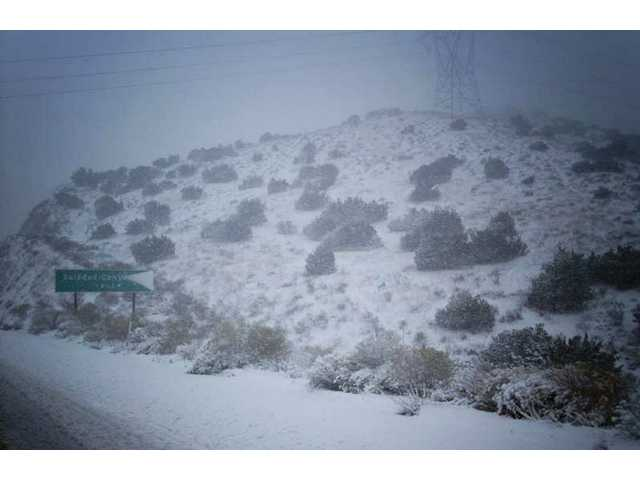 Snow covered the southbound 14 freeway this morning forcing travelers to crawl through south Palmdale, Acton and Agua Dulce. The northbound 14 is closed from 6.6 miles south of Palmdale at Soledad Canyon to the Junction of 138 due to snow.
