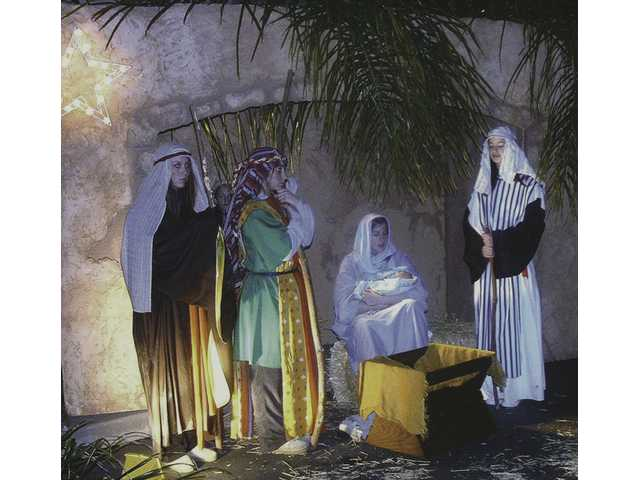 Pageant participants pose in a scene of Jesus' birth during last year's drive-through Living Nativity hosted by the Santa Clarita United Methodist Church. This year will mark the church's 26th Living Nativity. Guests can drive through anytime from 5:30 p.m. to 8 p.m. tonight and Sunday to experience the Christmas story at 26640 Bouquet Canyon Road in Saugus.