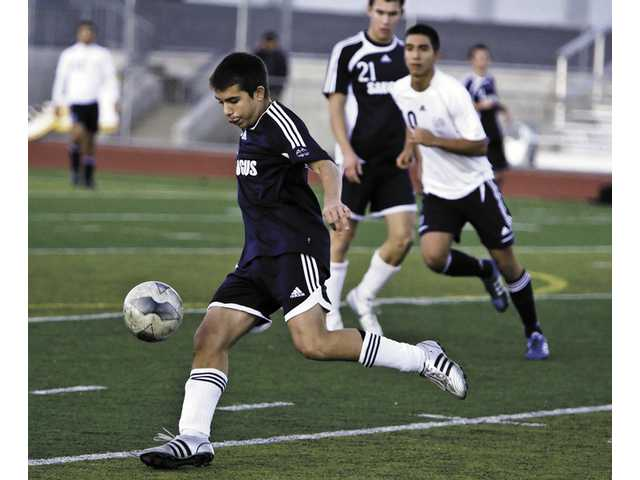 Centurion Timo Ros (15)  kicks the ball up towards midfield against Notre Dame of Sherman Oaks at Saugus on Friday. The Centurions won 3-1 behind Erick Esquivel's two goals.