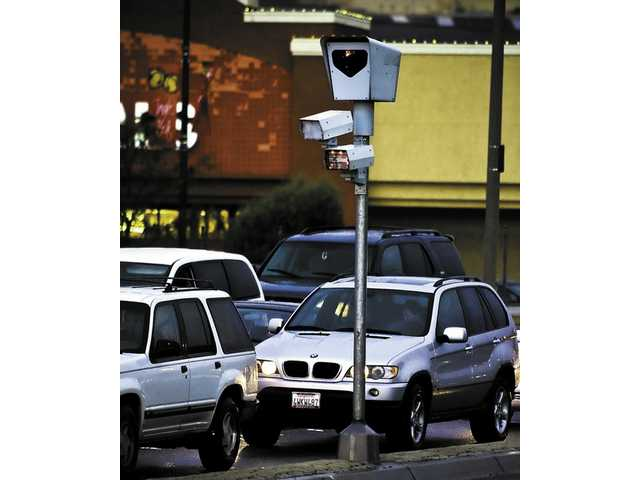 The red light camera at the intersection of Soledad Canyon Road and Whites Canyon Road uses infared technology to issue tickets with photographic evidence to traffic violators.