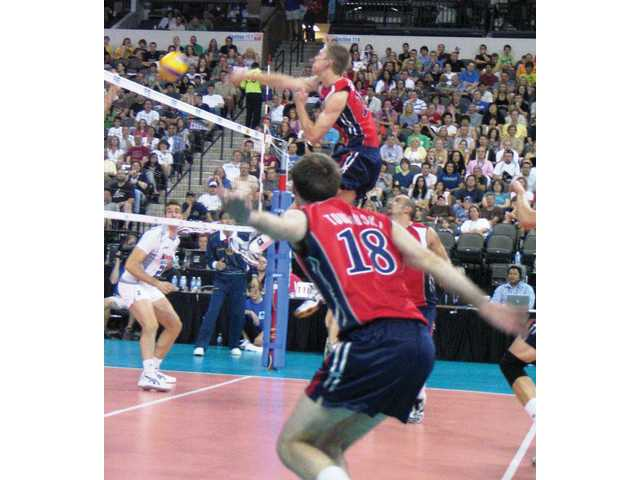 Saugus High graduate David Smith, top, spikes the ball as a member of the U.S. National Team during the summer of 2009. Smith won a national title at UC Irvine in 2007.