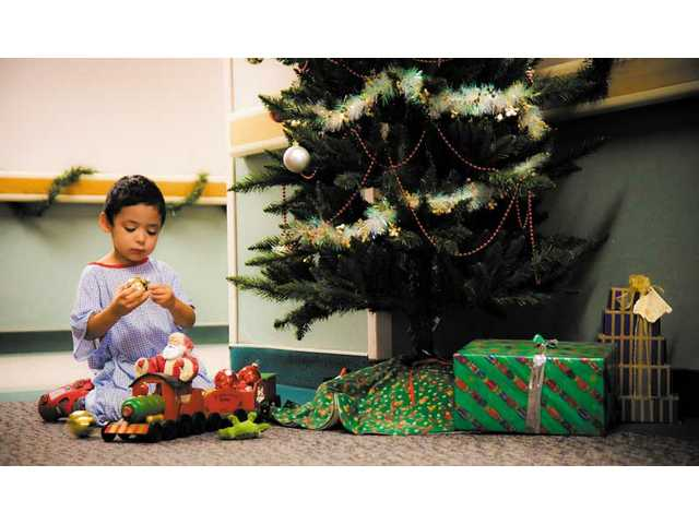 Dylan Olivas, 3, plays at Henry Mayo Newhall Memorial Hospital Tuesday.