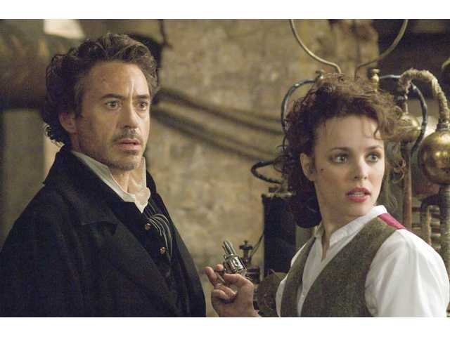 "Robert Downey Jr., left, and Rachel McAdams are shown in a scene from ""Sherlock Holmes."""