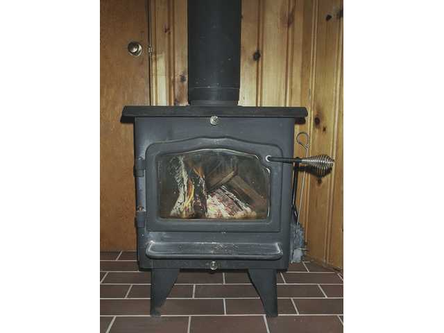 Quaint, old-fashioned wood-burning stoves are terrific heating and cooking tools, but should be observed carefully for fire and smoke dangers. A screen should always be used to prevent sparks and burning embers from escaping.