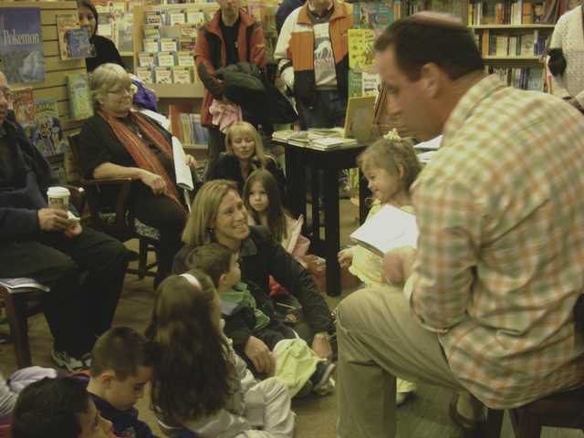 Rabbi Mark Blazer of Temple Beth Ami reads Chanukah stories to about 50 children and their parents Wednesday at Barnes & Noble in Valencia.