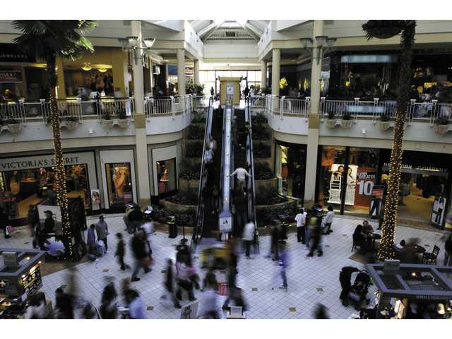Shoppers flock the Valencia Town Center in search of holiday bargains in this 2006 file photo.