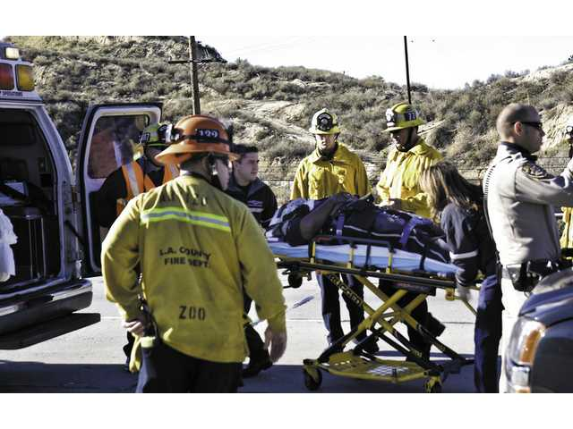 Williams is loaded into an ambulance after the crash Saturday afternoon on Highway 14. He was taken to Henry Mayo Newhall Memorial Hospital.