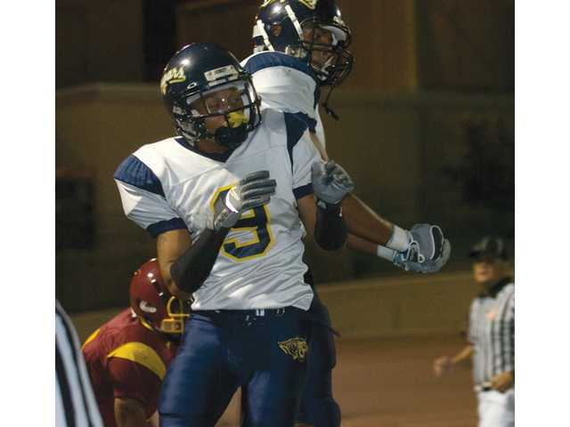 Cougar wide receiver Hayo Carpenter celebrates a touchdown reception against Bakersfield College on Nov. 15 in Bakersfield. Carpenter was named to the All-American first team.