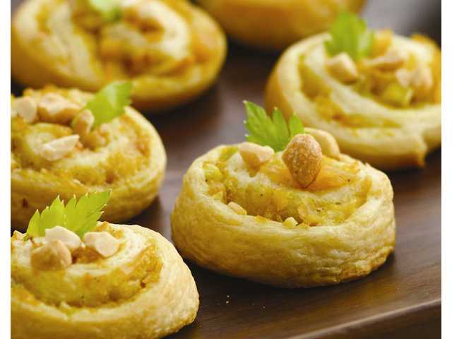 Chicken Curry Peanut Crescent Pinwheels Offer guests unexpected party-ready pinwheels with savory Indian spice and flavor combinations.Prep Time: 20 Minutes Start to Finish: 40 Minutes 1 can (8 oz) Pillsbury Crescent Recipe Creations refrigerated seamless dough sheet or 1 can (8 oz) Pillsbury refrigerated Crescent dinner rolls 1 can (4.5 oz) chunk white chicken breast in water, well drained 2 tablespoons mayonnaise or salad dressing 1 teaspoon curry powder 1/4 cup finely chopped celery 2 tablespoons apricot preserves or mango chutney 2 tablespoons chopped dry-roasted peanuts Additional chopped dry-roasted peanuts, if desired Celery or cilantro leaves, if desired Peanut sauce, if desired 1. Heat oven to 350°F. Spray large cookie sheet with cook­ing spray. If using dough sheet, unroll dough; cut into 4 rectangles. 2. If using crescent dough, unroll dough; separate into 4 rectangles and press perforations to seal. 3. In small bowl, mix chicken, mayon­naise and curry. Stir in celery, preserves and 2 tablespoons peanuts; mix well. 4. Spread about 2 tablespoons chicken mixture over each rectangle. 5. Starting with one short side, roll up each rectangle; pinch edges to seal. With serrated knife, cut each roll into 6 slices; place cut side down on cookie sheet. 6. Bake 13 to 17 minutes or until edges are golden brown. Garnish each with additional peanuts and celery leaves. Serve warm with peanut sauce for dipping. 24 servings