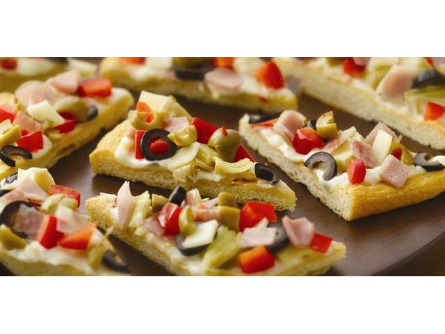 Crescent Antipasto BitesGuests will be drawn to this colorful dish that's simply a flaky crust layered with familiar antipasto ingredients. Prep Time: 20 Minutes Start to Finish: 1 Hour 10 Minutes 2 cans (8 oz each) Pillsbury refrigerated Crescent dinner rolls or 2 cans (8 oz each) Pillsbury Crescent Recipe Creations refrigerated seamless dough sheet 1 cup mayonnaise or salad dressing 2 teaspoons grated lemon peel 1 to 2 cloves garlic, finely chopped 2 jars (6 to 6 1/2 oz each) marinated artichoke hearts, well drained, chopped 6 slices provolone cheese (from 8-oz package), diced 4 oz thinly sliced Genoa salami (from deli), diced 2 oz thinly sliced smoked ham (from deli), diced 1/3 cup pimiento-stuffed olives, well drained, coarsely chopped 1 can (2 1/4 oz) sliced ripe olives, well drained 1/2 cup diced red bell pepper 1. Heat oven to 375°F. Unroll dough and place in an ungreased 15x10x1-inch pan; if using crescent dinner rolls, press perfora­tions to seal. Press in bottom and up sides to form crust. 2. Bake 13 to 17 minutes or until golden brown. Cool completely, about 30 minutes. 3. In medium bowl, mix mayon­naise, lemon peel and garlic until smooth. Spread over crust. Sprinkle evenly with remaining ingredients. 4. Cut into 16 squares; cut each square in half diagonally. 5. Serve immediately, or cover and refrigerate 1 to 2 hours before serving. 32 servings
