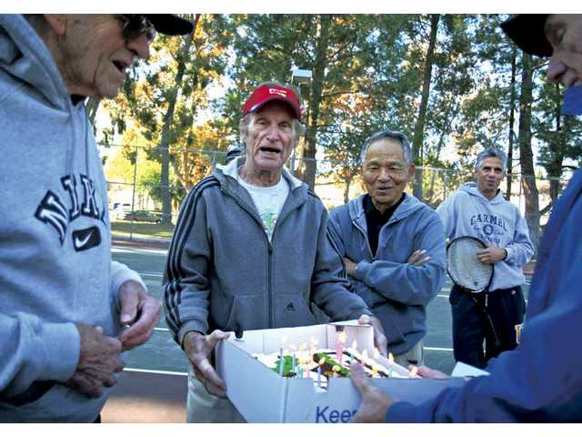 Ed Jace, 88, left, and Thor Jorgensen, 86, in red hat, celebrated their birthdays surrounded by their tennis buddies at Valencia Glen Park on Tuesday. The group meets five days a week to play tennis.