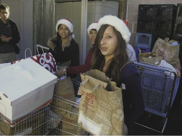 ASB members, wearing Santa hats, helped pack and load donated items onto trucks for delivery to the SCV Food Pantry Dec. 18.