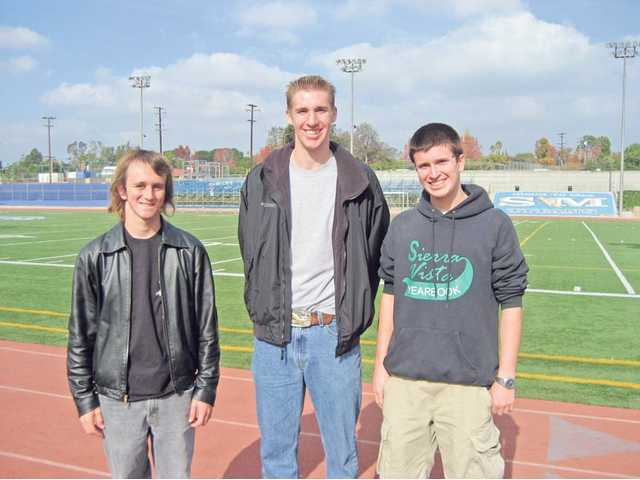 From left to right, Bill Hart District Eagle Scouts Christopher Nores, Curtis Van Grinsven and Tim Peak after marching practice at San Marino High School. The scouts will march in the 121st annual Rose Parade on New Year's Day.