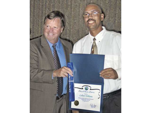 City of Santa Clarita Councilman Bob Kellar presents an award of service to Colbert Williams, who works at a local Vons, at the 10th Annual Pleasantview Industries Awards Banquet at the Santa Clarita Activities Center.