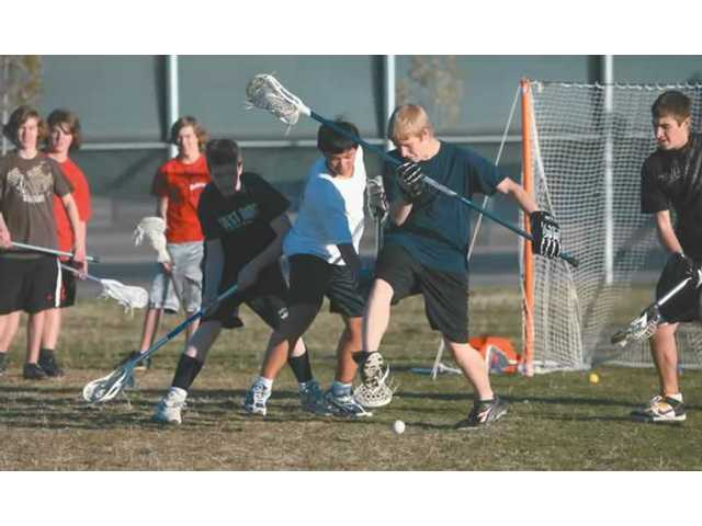 The Santa Clarita Valley Knights lacrosse team practices Thursday at Golden Valley High School. The Knights are one of just three youth lacrosse teams in the Santa Clarita Valley.