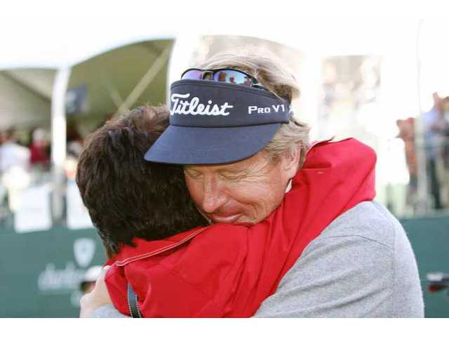 Dan Forsman gets a hug from proud wife Trudy moments after he won the 2009 AT&T Champions Classic at Valencia Country Club Sunday.