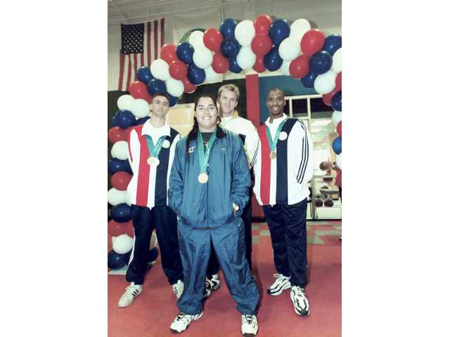 On Nov. 18, 2000, the city of Santa Clarita honored its local Olympians who competed in Sydney. Ervin, far left, stood alongside Valencia residents Adam Setliff, center back row, and Mark Crear, far right, and Canyon graduate Crystl Bustos. Crear won a bronze medal in the 110-meter high hurdles, Setliff competed in the discus and Bustos won gold in softball.