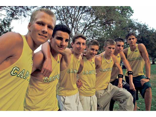 The Canyon boys won the 2001 CIF State Division I cross country championship with a team time of 80 minutes, 42 seconds. Members of the team are, from left, Jace Getskow, Mark Bingham, Troy Werner, Jameson Mora, Ryan Morgan, Alex Harris and Luke Llamas.