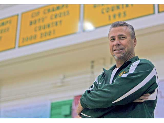 Canyon cross country head coach Dave DeLong has helped the program reach elite heights. But the sport has also been a welcome distraction for DeLong, who lost one son to cancer.