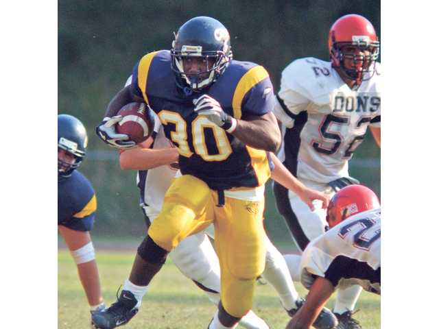 Former COC running back J.J. Arrington (30) rushes  against Santa Ana in 2002. Arrington went on to a successful career at the University of California, Berkeley, before being drafted by the Arizona Cardinals.