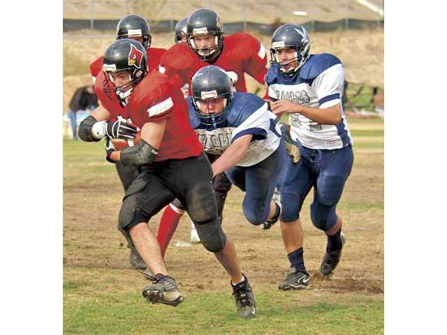 Santa Clarita Christian running back Orlandi Pena, with the ball, runs during a 2003 game.